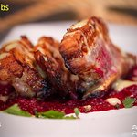 Grilled Pork ribs with lemon sauce on beetroot puree