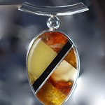 This pendant is a mosaic of Jet, amber and Silver - thousends of options and designs. Create your own design !!