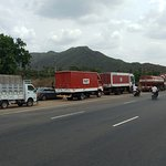 Vehicles lined-up in front of the Akka Hotel