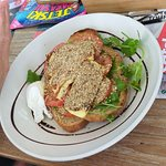 Dukka dusted haloumi (I think) with tomato on rye bread.