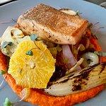 Salmon on roasted vegetables.