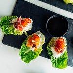 Sushi Bites - Scottish salmon & fresh tuna in baby gem leaves, with tobiko and wasabi yuzu soy dressing. 4 pieces.