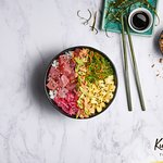 CLASSIC AHI TUNA HOUSE POKÉ BOWL.  Cubes of ahi tuna on a bed of white sushi rice with wakame seaweed, pickled red onion and pineapple, drizzled in our signature shoyu dressing.