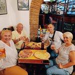 4 friends emjoying Pizza Night in Cave Canem Pizzeria, Rome