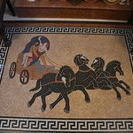 The marmor moseique in the hall of the Cultural Palace of Rhodes (Greece). Plouton got the Persephone and goes to the UnterWorld with 4 black wirld  horses. Around the Greek Meandros
