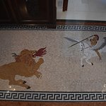 marmor mosaique in the first roof (entrance) of the Cultural Palace of Rhodes. Perseus on fly-horse Pegasus against the Chimmera! (monster of Greek Mythologie, with lions head with fire, body of horse, neck of sheep, and tai of a snake! (artist John Kostantinides) all marmor small pieces