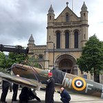 Assembly of plane in front of Cathedral