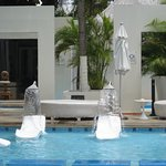 Water spout chairs around the pool.