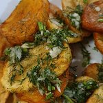 Fried home potatoes with garlic and dill