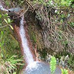 waterfall into a thermal pool