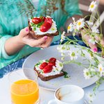 Rye bread with fresh ricotta, cherry tomatoes and spring onion