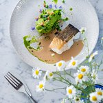 Cod with green pea purée, lardo and brown butter sauce