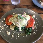 Eggs Benedict with herd roasted roma tomato, spinach & feta with no bread