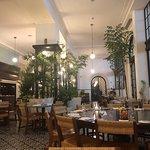 ภาพถ่ายของ Dining Room at American Trade Hotel