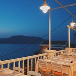 Restaurant at night with sea view.