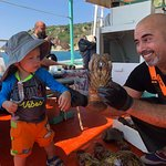 What a Great Day! Our family enjoying the swim and oh my that Deliciousness Food Antonia and Michalis prepared. Hassan s the man in charge of the nets. Antonia is such a warm caring person as seen in the picture of her holding our grandson.