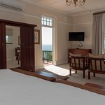 The Deluxe Suite with its own private balcony, amazing sea view and a huge bathroom with shower and ball and claw bath