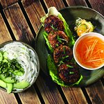 Bun Cha - one of Hanoi's favourites: Traditional minced Pork Belly patties mixed with fresh Vietnamese Herbs and grilled to perfection on our coal BBQ, with Rice Noodles & home-made Fish Sauce dip on the side..