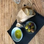 With first glass drank inside a bread and olive platter is for free per table