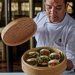 Chef Nazlan presenting a Bao Bun Beef Brisket