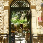 Arched entrance to pretty courtyard