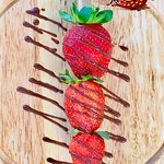 Frozen strawberries on stick with chocolate