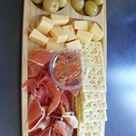 Delicious cold meat, cheese and olives with salty crackers. Perfect picnic snack