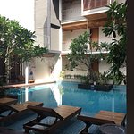 Pool area, surrounded by rooms but open to the sky
