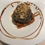 Seared tuna with sesame seed crust and vegetable base.
