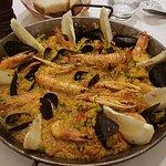 Seafood paella and tuna rolls with almonds