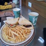 Extreme veggie sandwich with fries. By