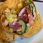 Up close picture of the blackened ahi tuna wrap- arrived rare as requested. Tarter sauce was hel