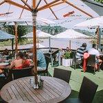 Summer dining on The Landing Restaurant's outdoor decks overlooking the water