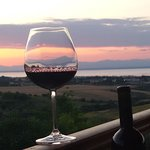 """having a glass from our summer red """"SYMPHONY"""" a blend consisting xinomavro grapes, syrah and agiorgitiko, at our balcony at sunset"""