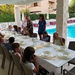 Kids dinner outside at the pool
