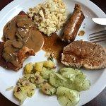 jaegerschnitzel, spaetzle with cheese, bratwurst, pork roast, cucumber salad (not sure of the na