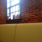 The old brick wall and bench seat backs. Chairs were on the other side of the tables. I found th