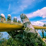 The 'shimmering' structure has aged green hands which look like 'they 've been there for centuries',  and let enjoy with us on tour Golden Bridge as link :https://hoiantravel.com/tours/ba-na-hill-golden-bridge/