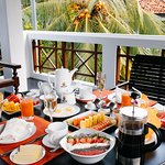 breakfast on the balcony of the Deluxe room 4