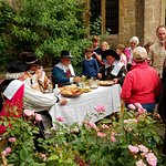 High table members of The Marquis of Winchester's Regiment of ECWS being served food and educating the visitors.