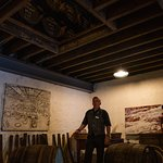 Mike, our phenomenal tour guide, just below casks of Oban whisky
