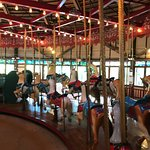 Riding the historic 1914 carousel.