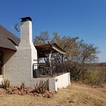 The thatched cottage is perched up on the river bank.  The patio is a most enjoyable place to see the view, listen to the rippling of the river, braai and read.