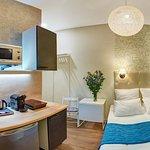 Номер Апартаменты-студия со всем необходимым: кухня с техникой, ванная комната.