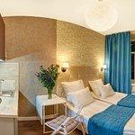 Компактный номер Апартаменты-студио с двуспальной кроватью, кухонной зоной и ванной комнатой.