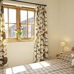 Bedroom in Fisherman's Lodge, overlooking the gardens.
