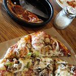 Enjoying the lunch specials: individual  pepperoni pizza & flatbread vegetarian pizza. Both came with caesar salad!