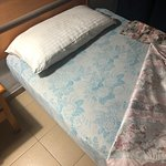 Disgusting and old unmade bed on arrival