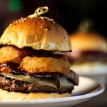 BBQ Beef Burger with onion rings and Swiss cheese