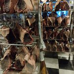 Glass case of sides of meat, inside the restaurant